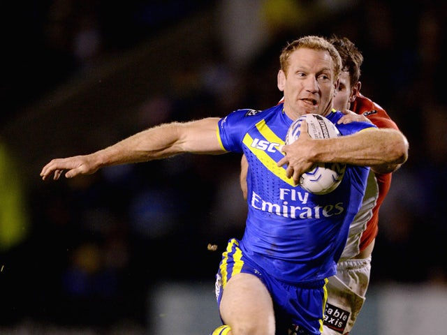 Michael Monaghan of Warrington Wolves in action during the Super League match between Warrington Wolves and St Helens at The Halliwell Jones Stadium on February 13, 2014