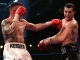 Mikkel Kessler of Denmark (L) lands a left cross on Carl Froch of England during their Super Six WBC Super Middleweight title fight on April 24, 2010