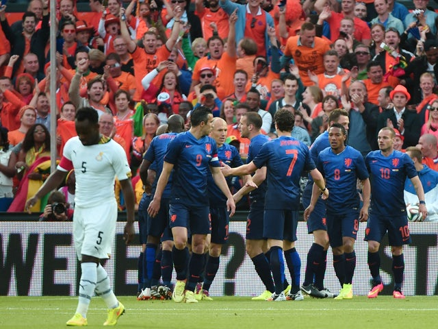 Netherlands' forward Robin van Persie is congratulated by teammates after scoring a goal during the international friendly football match Netherlands against Ghana on May 31, 2014