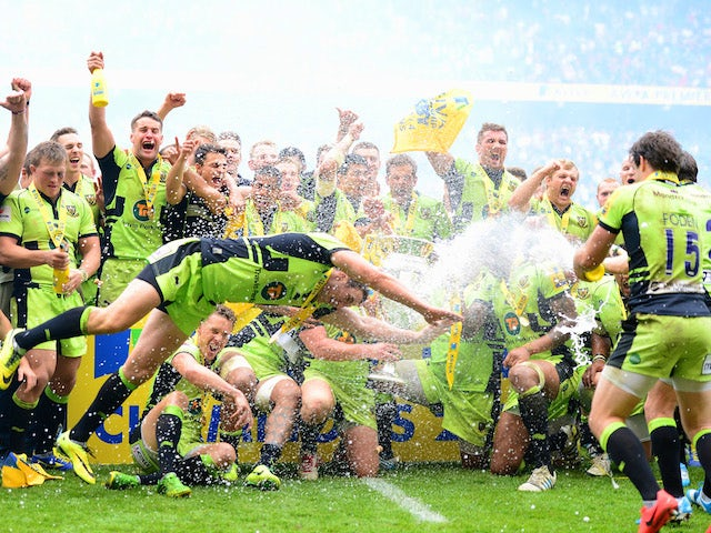 Northampton Saints players celebrate winning the Aviva Premiership Final at Twickenham on May 31, 2014