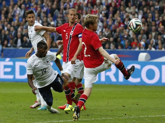 France's midfielder Paul Pogba (L) scores a goal during the friendly football match France vs Norway on May 27, 2014