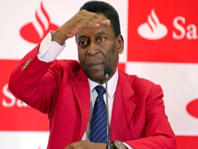 Brazilian former football star Edson Arantes do Nascimento, aka 'Pele', gestures during a press conference on May 19, 2014