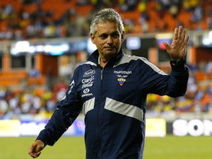 Ecuador coach Reinaldo Rueda waves to supporters before a match against Honduras on November 19, 2013.