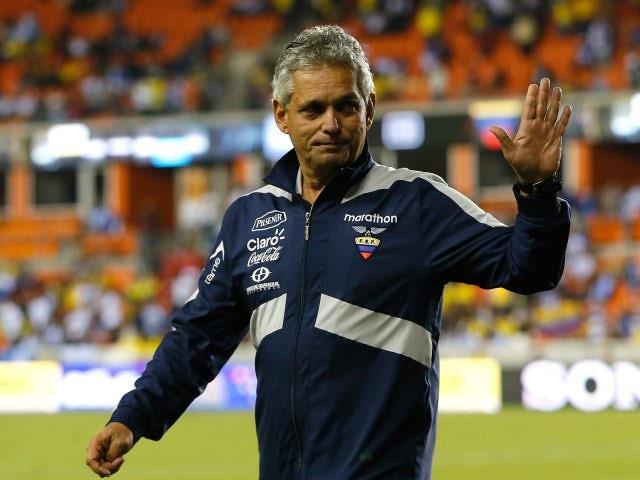 Ecuador coach Reinaldo Rueda waves to supporters before a match against Honduras on November 19, 2013.