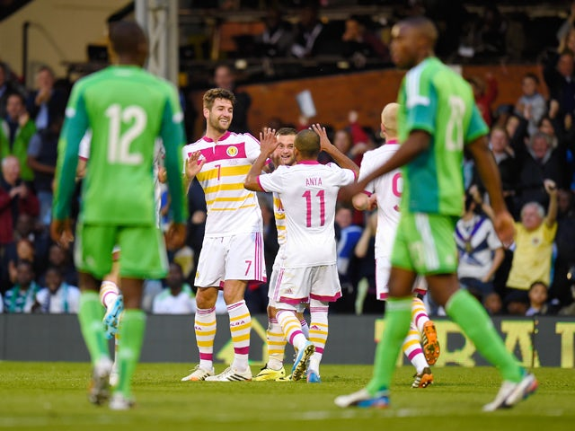 Charlie Mulgrew of Scotland celebrates with teamates after scoring during an International Friendly between Scotland and Nigeria at Craven Cottage on May 28, 2014