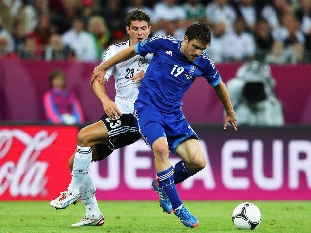 Greece defender Sokratis Papastathopoulos holds off a challenge from German striker Mario Gomez on June 22, 2012.