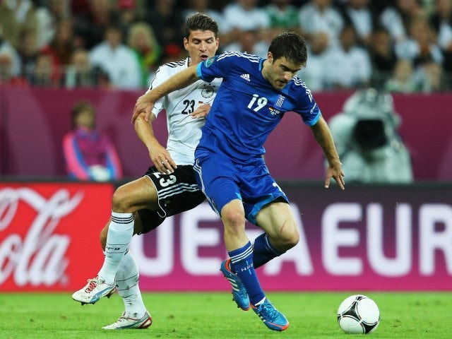 Greece defender Sokratis Papastathopoulos holds off a challenge from German striker Mario Gomez on June 22, 2012.