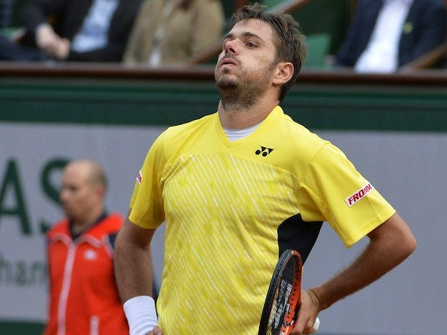 Stanislas Wawrinka reacts after losing a point to Spain's Guillermo Garcia-Lopez during their French tennis Open first round match at the Roland Garros stadium in Paris on May 26, 2014