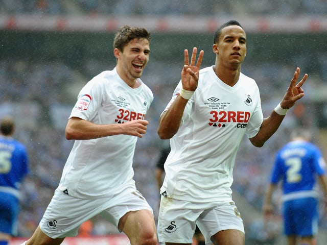 Scott Sinclair of Swansea celebrates his third goal with Fabio Borini during the npower Championship Playoff Final between Reading and Swansea City at Wembley Stadium on May 30, 2011