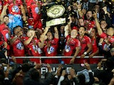 Jonny Wilkinson, Captain of Toulon raises the trophy after Toulon wins the Top 14 Final between Toulon and Castres Olympique at Stade de France on May 31, 2014
