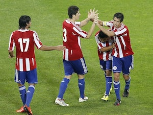 Paraguay's midfielder Victor Caceres celebrates after scoring a goal during the international friendly football match France vs Paraguay, on June 01, 2014