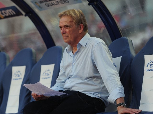 Volker Finke sits in the dugout ahead of Cameroon's match against Tunisia on October 13, 2013.