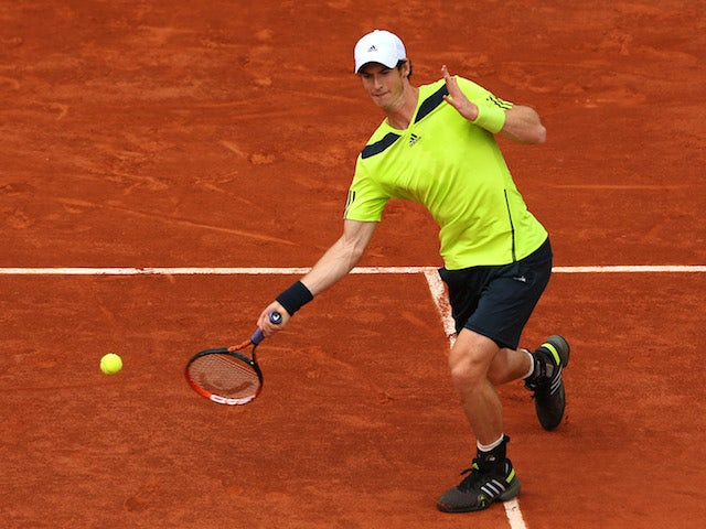 Andy Murray plays a forehand stroke during his French Open fourth round match against Fernando Verdasco at Roland Garros on June 2, 2014