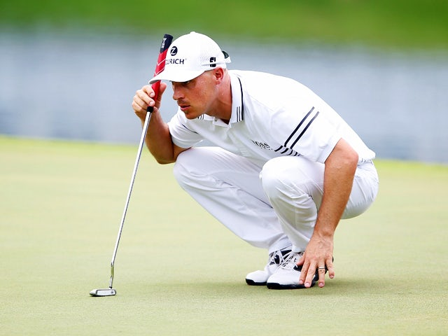 Ben Crane lines up a putt on the 18th green during the second round of the FedEx St. Jude Classic at the TPC Southwind on June 6, 2014