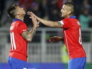Chile beat Uruguay to reach semi-finals