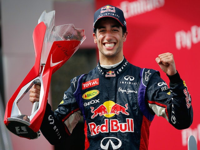 Racewinner Daniel Ricciardo of Australia and Infiniti Red Bull Racing lifts the trophy following his victory during the Canadian Formula One Grand Prix on June 8, 2014