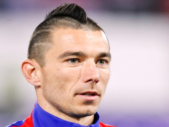 Croatia's midfielder Danijel Pranjic listens to the national anthem before the start of the 2014 World Cup international friendly football match between Switzerland and Croatia on March 5, 2014