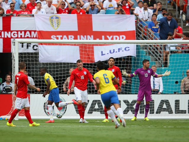 Enner Valencia of Ecuador turns to celebrate after scoring the first goal as Ben Foster of England reacts during the International friendly match between England and Ecuador at Sun Life Stadium on June 4, 2014