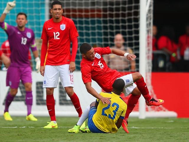 Carlos Gruezo of Ecuador brings down Alex Oxlade-Chamberlain of England during the International friendly match between England and Ecuador at Sun Life Stadium on June 4, 2014