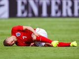 Jack Wilshere of England lies injured during the International friendly match between England and Ecuador at Sun Life Stadium on June 4, 2014