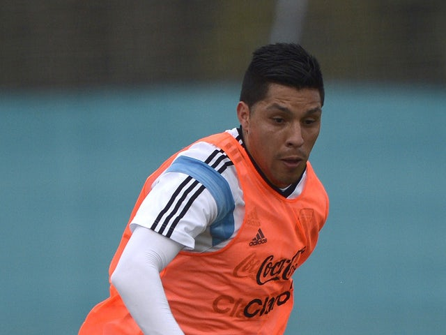 Argentina's midfielder Enzo Perez controls the ball during a training session in Ezeiza, Buenos Aires, Argentina on May 31, 2014