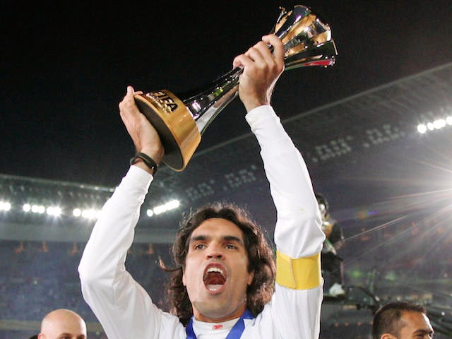 Internacional captain Fernandao (C) holds the champion trophy after their final match against FC Barcelona for the FIFA Club World Cup on December 16, 2006