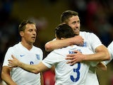Gary Cahill is congratulated by Leighton Baines after he scores for England against Peru on May 30, 2014.