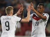 Germany's midfielder Andre Schurrle celebrates scoring with teammate Germany's defender Jerome Boateng during the friendly football match Germany vs Armenia in preparation for the FIFA World Cup 2014 on June 6, 2014