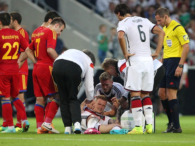 Germany's midfielder Marco Reus reacts injured on the pitch during the friendly football match Germany vs Armenia in preparation for the FIFA World Cup 2014 on June 6, 2014