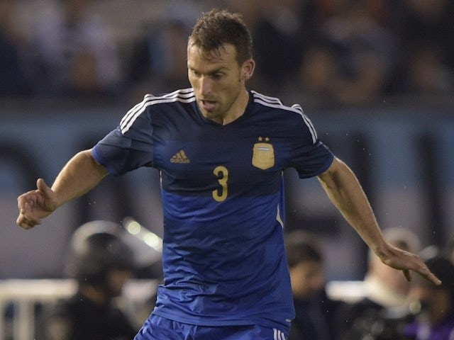 Argentina's defender Hugo Campagnaro controls the ball during a friendly football match against Trinidad and Tobago at the Monumental stadium in Buenos Aires, Argentina on June 4, 2014