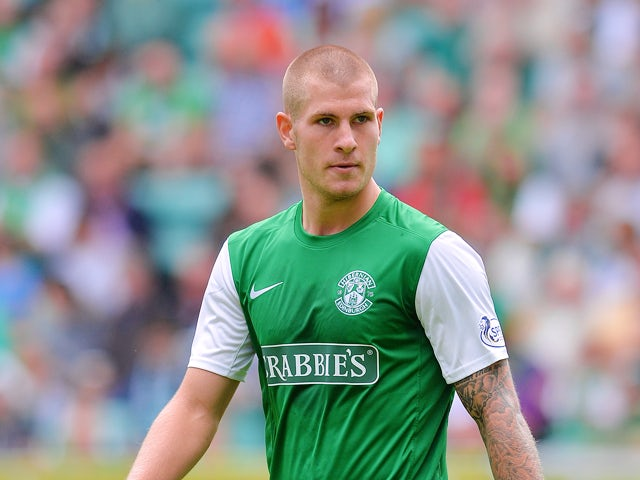 James Collins of Hibernian in action during the Scottish Premiership League match between Hibernian and Motherwell at Easter Road on August 04, 2013