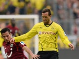 Dortmund's striker Julian Schieber and Hanover's midfielder Edgar Prib vie for the ball during the German first division Bundesliga football match Borussia Dortmund vs Hannover 96 in Dortmund, western Germany on October 19, 2013