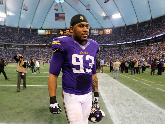 Kevin Williams #93 of the Minnesota Vikings walks off the field after defeating the Detroit Lions on December 29, 2013