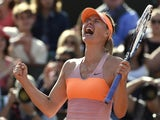 Russia's Maria Sharapova celebrates her victory over Canada's Eugenie Bouchard at the end of her French tennis Open semi-final match against at the Roland Garros stadium in Paris on June 5, 2014