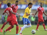 Neymar (R) of Brazil and Alberto Quintero of Panama compete for the ball during the International Friendly Match between Brazil and Panama at Serra Dourada Stadium on June 3, 2014