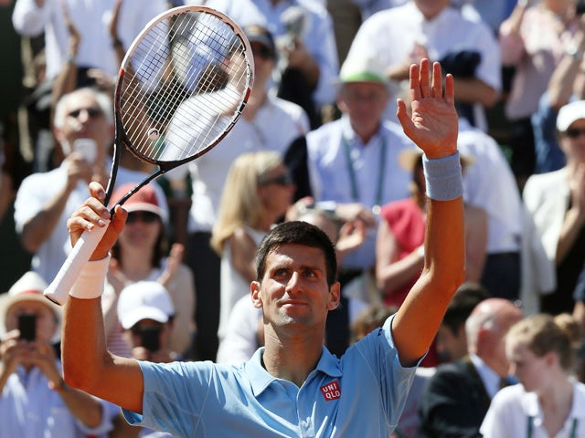 Serbia's Novak Djokovic celebrates his victory over Latvia's Ernests Gulbis at the end of their French tennis Open semi-final match at the Roland Garros stadium in Paris on June 6, 2014