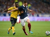 France's forward Olivier Giroud (R) vies with Jamaican's defender Kemar Lawrence during the friendly football match between France and Jamaica at the Pierre Mauroy stadium, on June 08, 2014