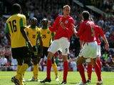 Peter Crouch celebrates scoring the first of his three goals for England against Jamaica on June 03, 2006.