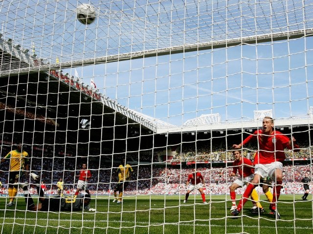 Peter Crouch scores the second of his three goals for England against Jamaica on June 03, 2006.