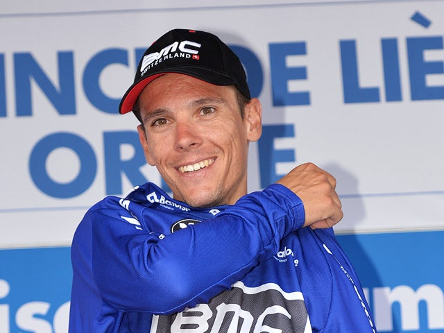 Belgian cyclist Philippe Gilbert of the BMC Racing Team celebrates on the podium after winning the points ranking after the final stage of the Baloise Belgium Tour cycling race, 178,7 km from Oreye to Oreye, on June 1, 2014