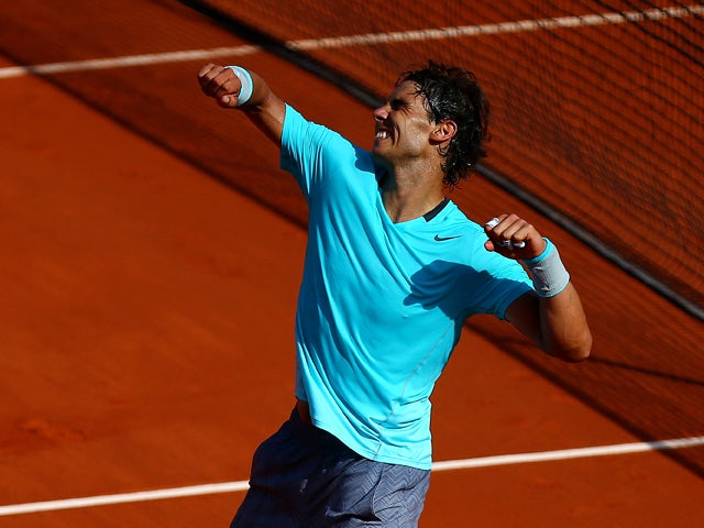 Rafael Nadal of Spain celebrates victory in his men's singles match against Andy Murray of Great Britain on day thirteen of the French Open at Roland Garros on June 6, 2014
