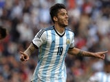 Argentina's midfielder Ricky Alvarez (C) celebrates after scoring against Slovenia during a friendly football match at La Plata stadium in La Plata, Buenos Aires, Argentina on June 7, 2014