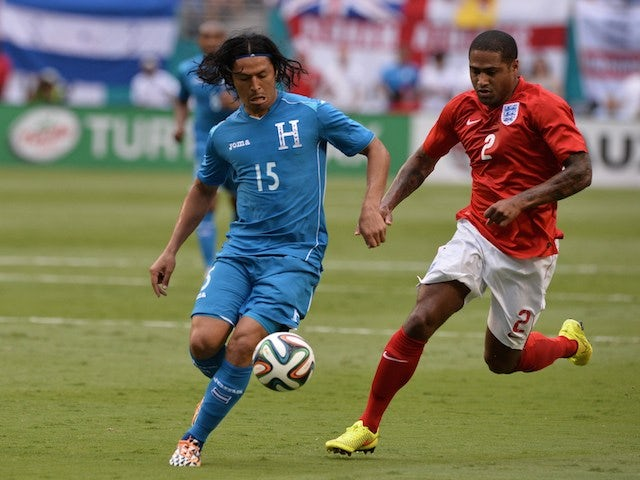 Honduras' midfielder Roger Espinoza (L) vies for the ball with England's defender Glen Johnson before the friendly game on June 7, 2014