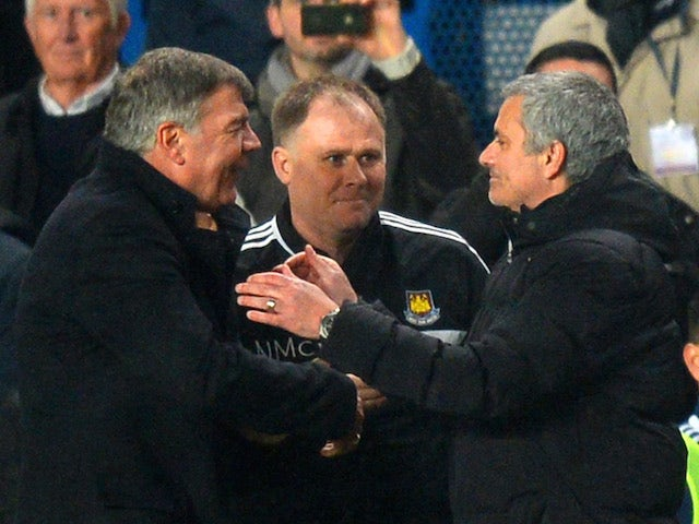 West Ham United's English manager Sam Allardyce (L) shakes hands with Chelsea's Jose Mourinho (R) after the English Premier League football match on January 29, 2014