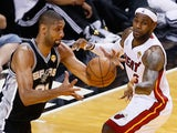 Tim Duncan #21 of the San Antonio Spurs with the ball against LeBron James #6 of the Miami Heat during the NBA Finals on June 20, 2013