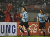 Uruguay's forward Christian Stuani celebrates with teammate Edison Cavani after scoring against Slovenia during a friendly football match on June 4, 2014