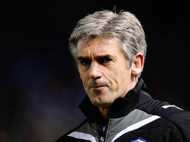 Alan Irvine, then in charge of Sheffield Wednesday, looks on during a Championship game on March 24, 2010