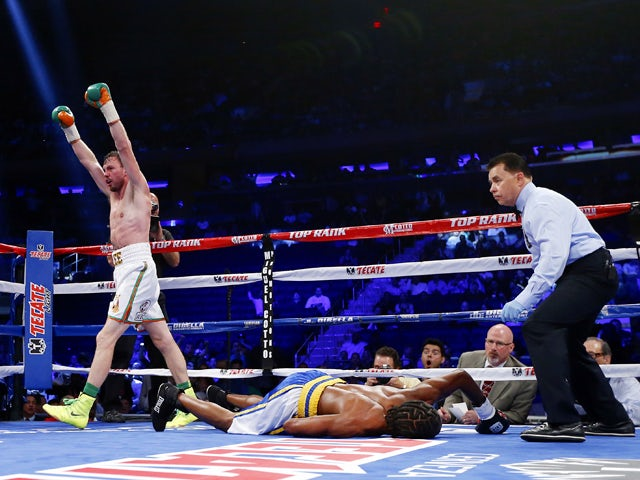 Andy Lee of Ireland raises his arms after knocking out John Jackson of theVirgin Islands in the fifth round of their NABF Super Welterweight title fight on June 7, 2014