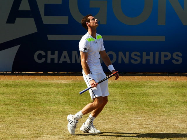 Andy Murray of Great Britain reacts in his match against Radek Stepanek of the Czech Republic during their Men's Singles on day four of the Aegon Championships at Queens Club on June 12, 2014