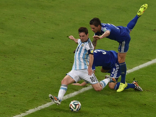 Argentina's forward and captain Lionel Messi prepares to kick the ball to score his team's second goal during the Group F football match between Argentina and Bosnia Hercegovina at the Maracana Stadium in Rio De Janeiro during the 2014 FIFA World Cup on J